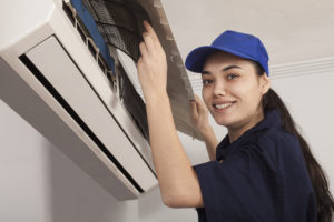 technician servicing a ductless system